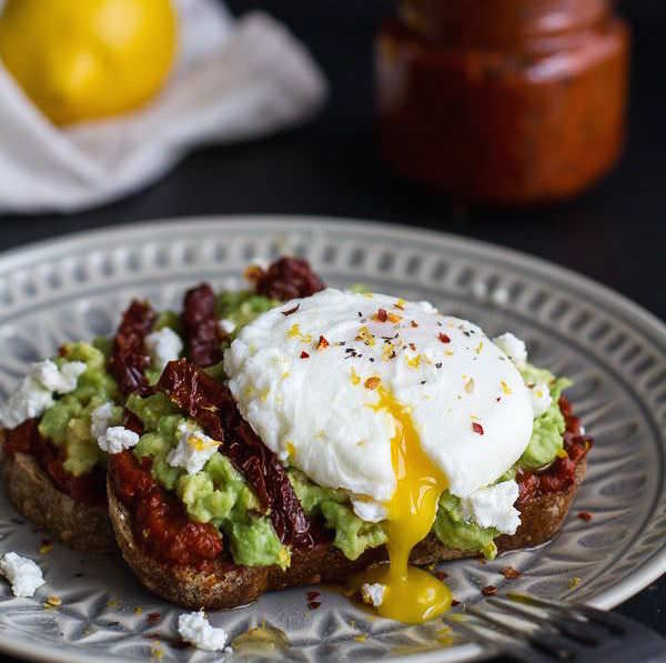 Harissa-Smashed-Avocado-Egg-Toast-with-Goat-Cheese-and-Honey-Drizzle