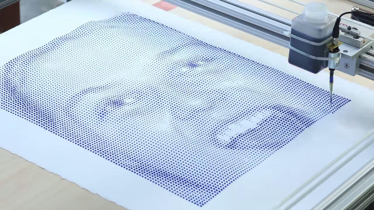 水滴をドリッピングしていき絵を描く機械