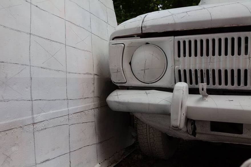 Russian street artists delete car optical illusion 6
